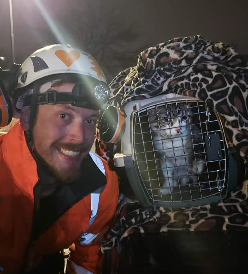 Tim with a stray cat he rescued from a tree